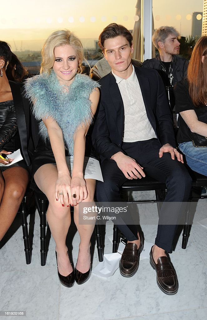 Pixie Lott and Oliver Cheshire attend the Mark Fast salon show during London Fashion Week Fall/Winter 2013/14 at ME Hotel on February 17, 2013 in London, England.