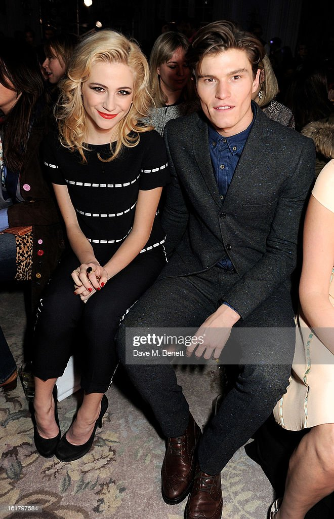 Pixie Lott (L) and Oliver Cheshire attend the Moschino cheap&chic show during London Fashion Week Fall/Winter 2013/14 at The Savoy Hotel on February 16, 2013 in London, England.