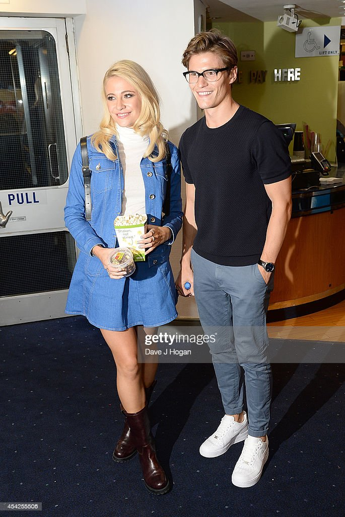 Pixie Lott and Oliver Cheshire attend the UK Premiere of 'The Guvnors' at Odeon Covent Garden on August 27, 2014 in London, England.