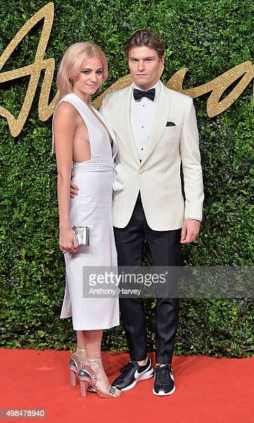 Pixie Lott and Oliver Cheshire attends the British Fashion Awards 2015 at London Coliseum on November 23 2015 in London England
