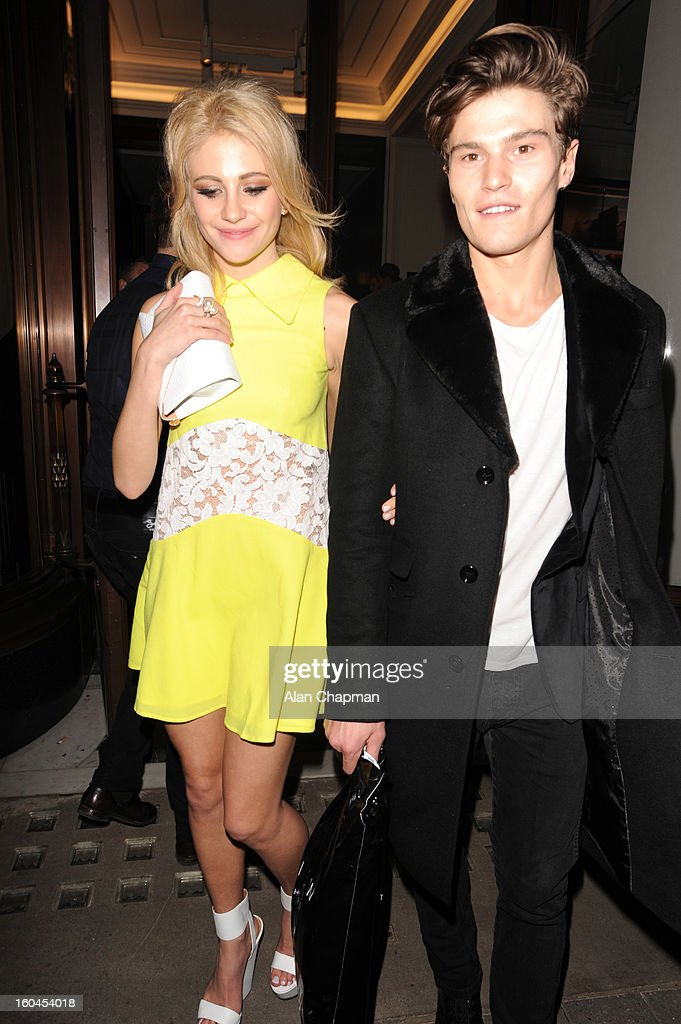 Pixie Lott and Oliver Cheshire sighting at Burberry on January 31, 2013 in London, England.