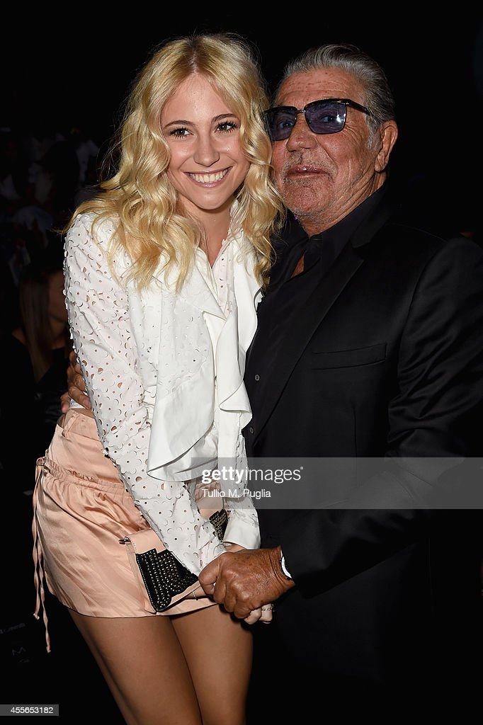 Pixie Lott and Roberto Cavalli attend the Just Cavalli show during the Milan Fashion Week Womenswear Spring/Summer 2015 on September 18 2014 in Milan...