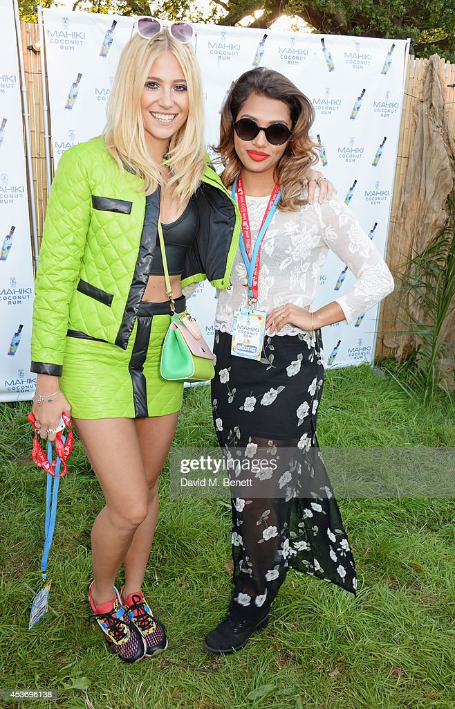 Pixie Lott (L) and Vanessa White attend the Mahiki Rum Bar for the launch of the Mahiki Rum Family backstage during day 1 of the V Festival 2014 at Hylands Park on August 16, 2014 in Chelmsford, England.