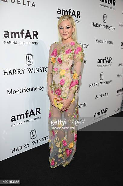 Pixie Lott arrives at amfAR Milano 2015 at La Permanente on September 26 2015 in Milan Italy