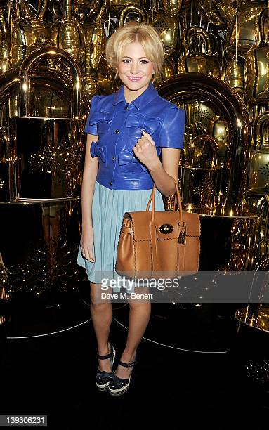 Pixie Lott arrives at the Mulberry Autumn/Winter 2012 show during London Fashion Week at Claridge's Hotel on February 19 2012 in London England