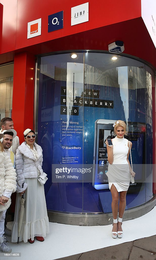 Pixie Lott (R) attends a photocall to launch the new BlackBerry Z10 smartphone at Phones4u, Oxford Street on January 31, 2013 in London, England.