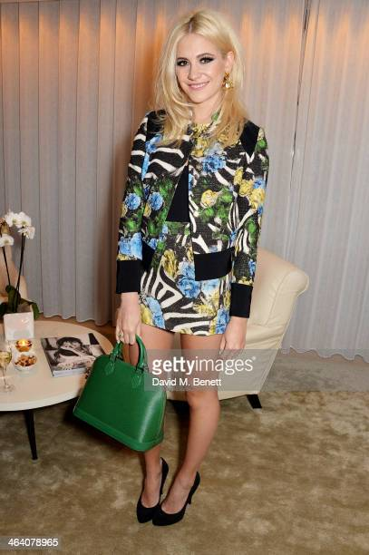 Pixie Lott attends the 'GUESS Loves Priyanka' VIP Dinner at the London Edition Hotel on January 20 2014 in London England