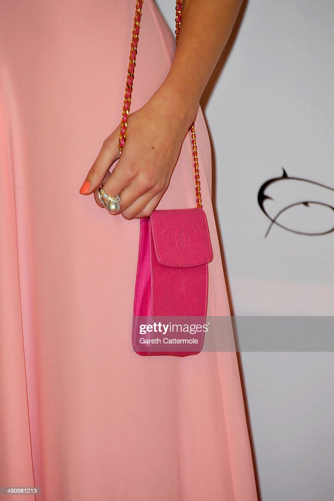 Pixie Lott (Chanel purse detail) attends the London Global Gift Gala at ME Hotel on November 19, 2013 in London, England.