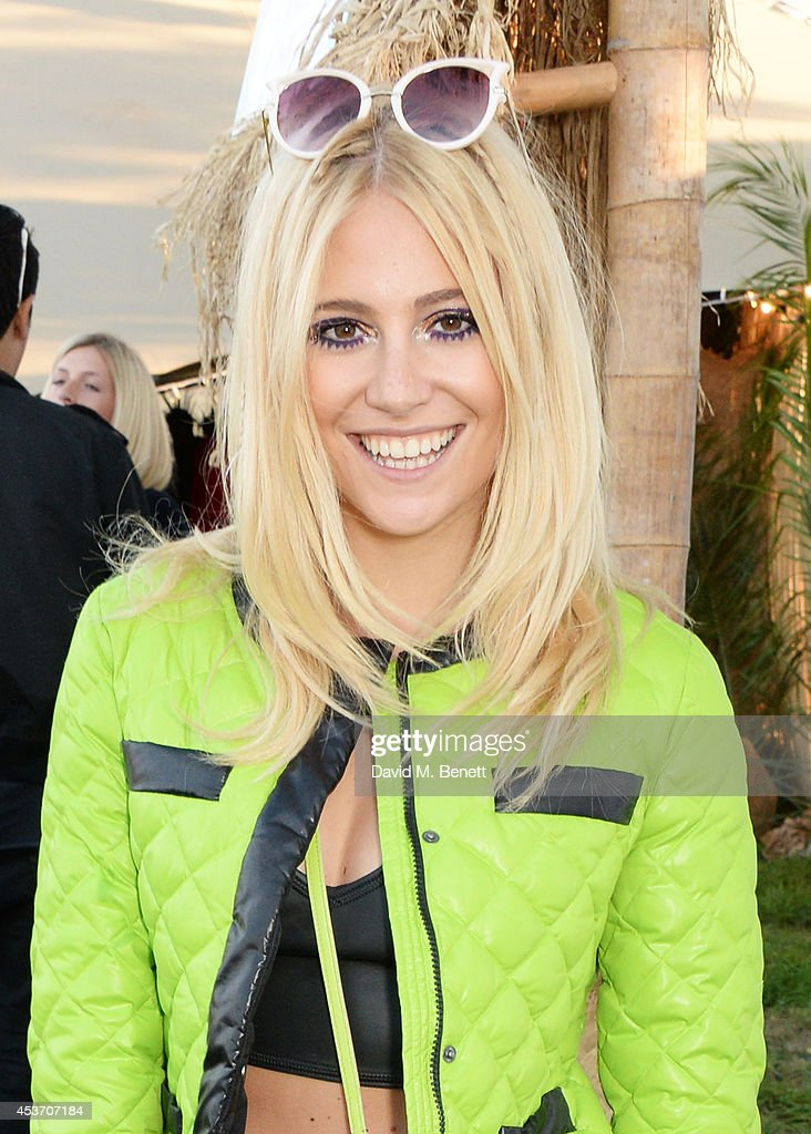 Pixie Lott attends the Mahiki Rum Bar for the launch of the Mahiki Rum Family backstage during day 1 of the V Festival 2014 at Hylands Park on August 16, 2014 in Chelmsford, England.