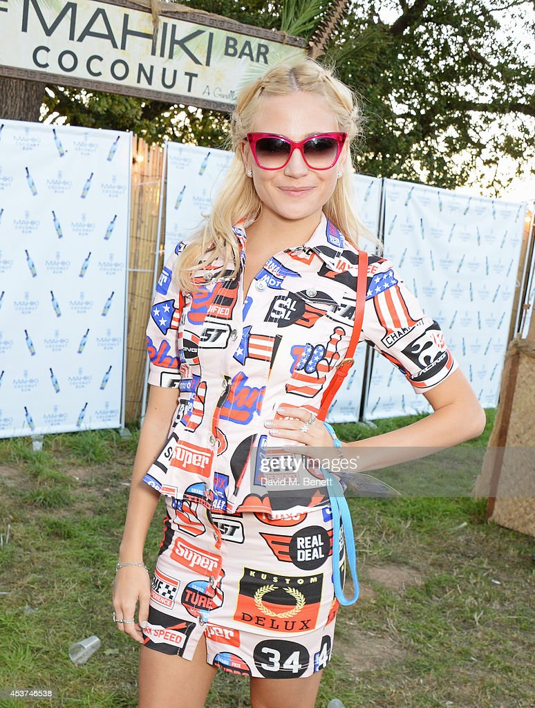 Pixie Lott attends the Mahiki Rum Bar for the launch of the Mahiki Rum Family backstage during day 2 of the V Festival 2014 at Hylands Park on August 17, 2014 in Chelmsford, England.