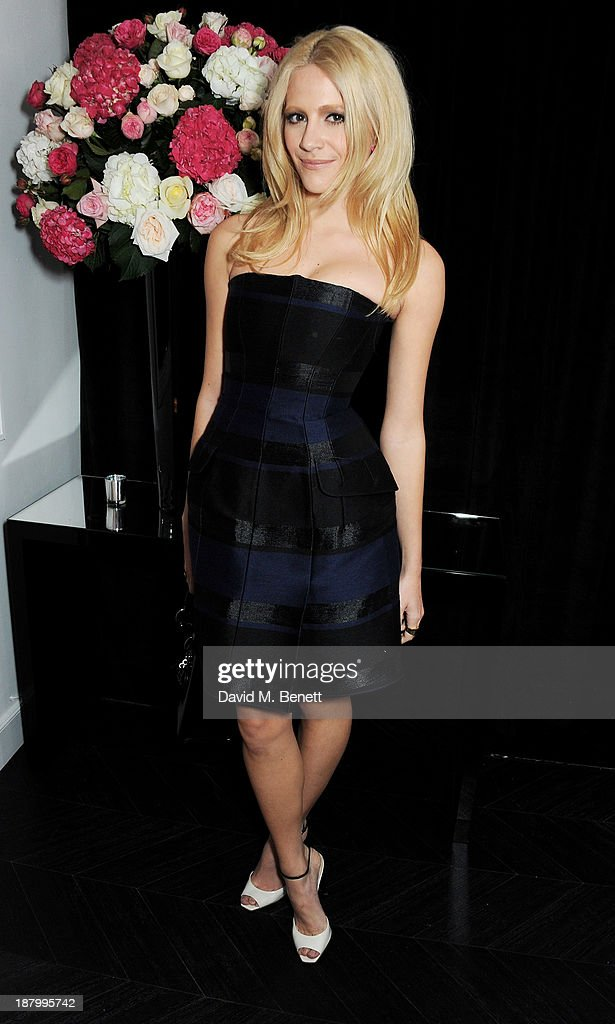 Pixie Lott attends the opening of the Dior Beauty Boutique in Covent Garden on November 14, 2013 in London, England.