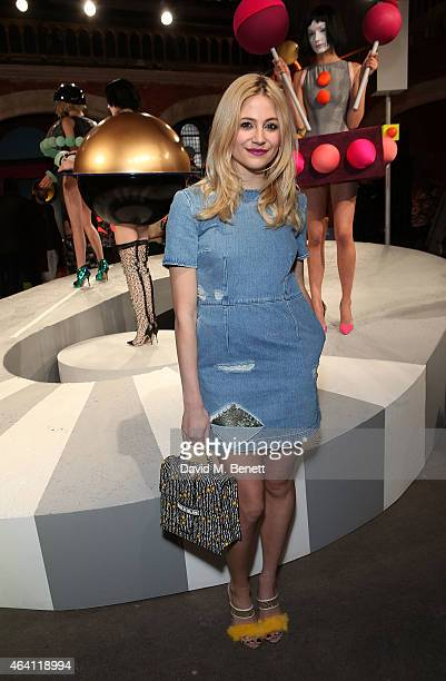Pixie Lott attends the Sophia Webster presentation during London Fashion Week Fall/Winter 2015/16 at The Welsh Chapel on February 22 2015 in London...