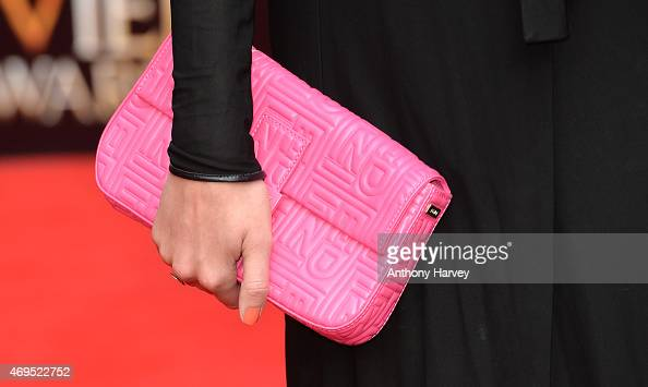 Pixie Lott bag detail attends The Olivier Awards at The Royal Opera House on April 12 2015 in London England
