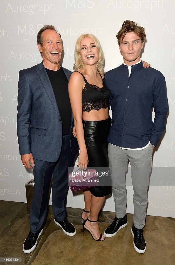 Pixie Lott, Oliver Cheshire and his father Graham Cheshire attend the Marks & Spencer party to launch Oliver Cheshire as the Face of Autograph Menswear on September 3, 2015 in London, England.