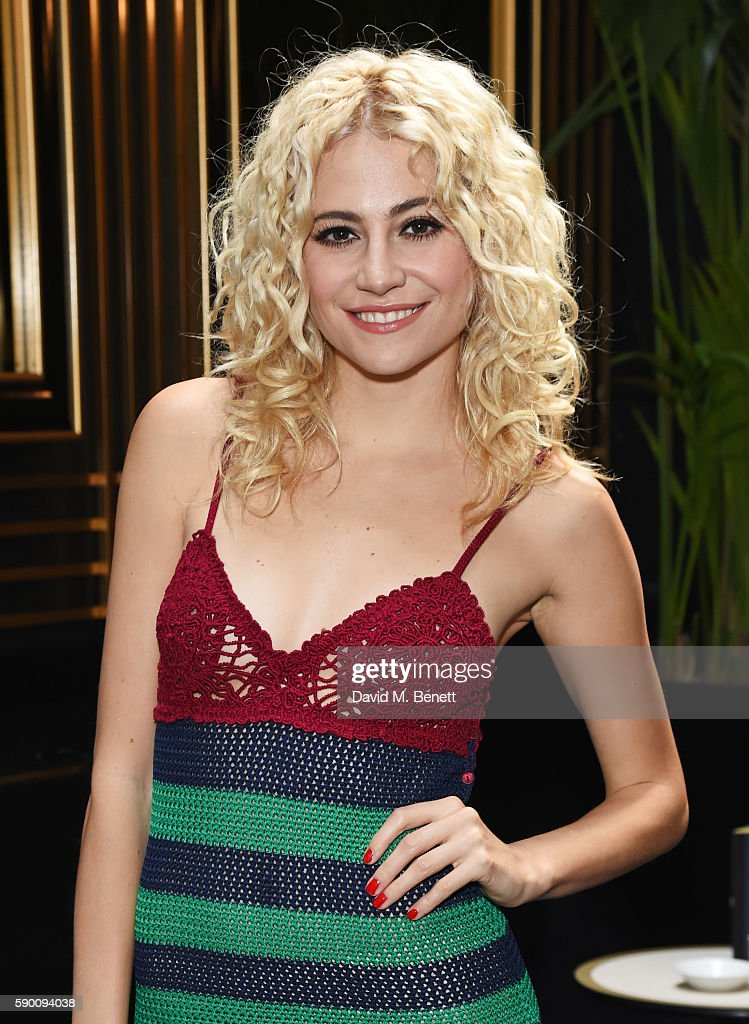 Pixie Lott poses at the launch of her limited edition track 'A Real Good Thing' with Select Model Management at Tramp on August 16, 2016 in London, England.