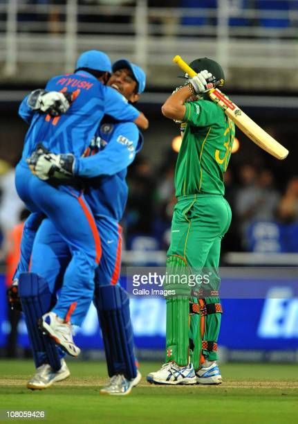 Piyush Chawla and Mahendra Singh Dhoni celebrate as Wayne Parnell of South Africa reacts after losing his wicket to give India victory during the 2nd...