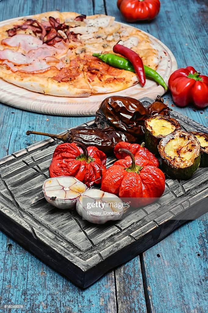 pizza and baked vegetables : Stock Photo