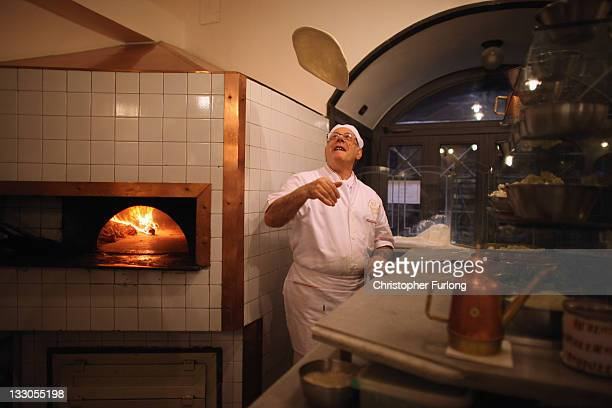 Pizza chef Pepe Mazza spins the dough in the world reknowned Lombardi Pizzeria on November 16 2011 in Naples Italy Italian Prime Minster designate...