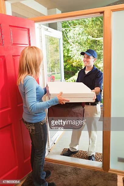 Pizza Delivery Man Delivering to Residential Home for Takeout Service