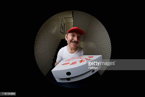 A pizza delivery man, viewed through peephole