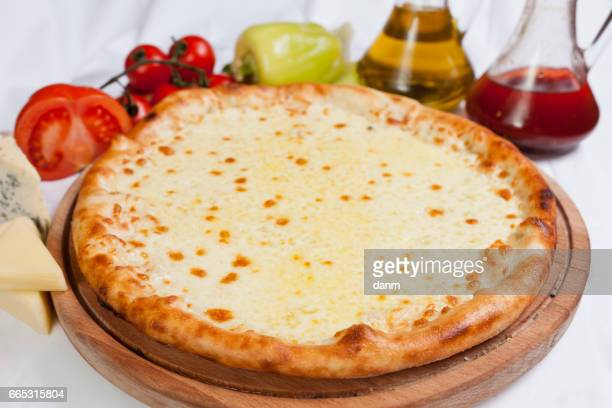 Pizza foccacia on a white background with ingredients around