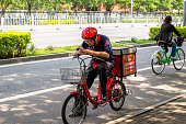 A pizza hut takeout deliveryman stops at roadside Yum which includes Pizza Hut and KFC earns about 50 percent of its revenue in China but the sales...