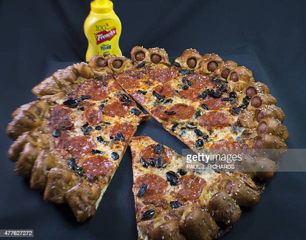 Pizza Hut's Hot Dog Bites Pizza a new belly busting pizza surrounded by 28 small hot dogs wrapped in a salted pretzel like crust is seen June 18...