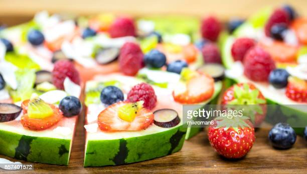 Pizza made with fresh fruits. Fruit Art Recipe. Food art creative concepts.