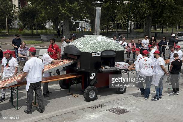 Pizza makers attempt to break the Guinness World Record for the longest in the world on the seafront of Naples Italy on May 18 2016 The goal is to...