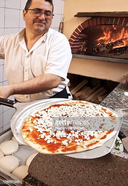 pizza man baking pizza margherita