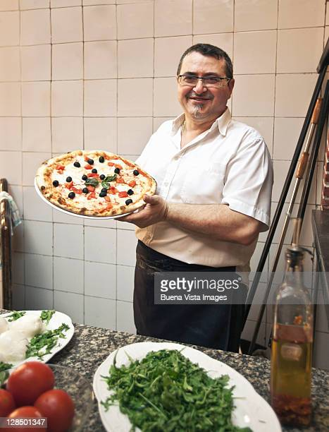 pizza man baking pizza margherita