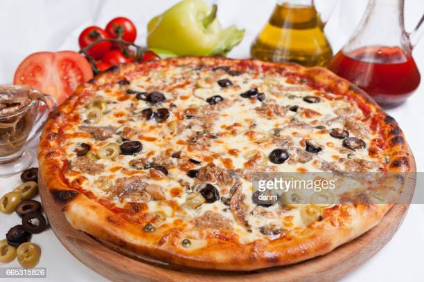 Pizza marinara on a white background with ingredients around