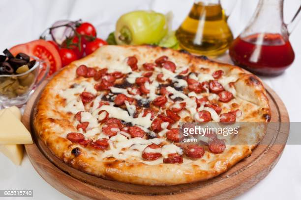 Pizza on a white background with ingredients around