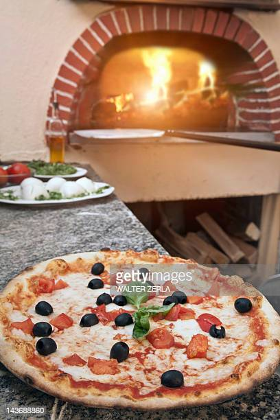 Pizza on counter in kitchen