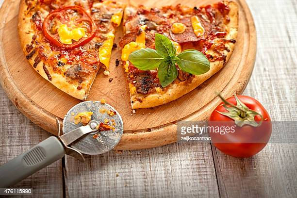 pizza on the wooden table