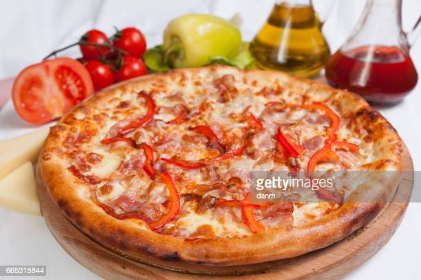 Pizza pomodoro on a white background with ingredients around