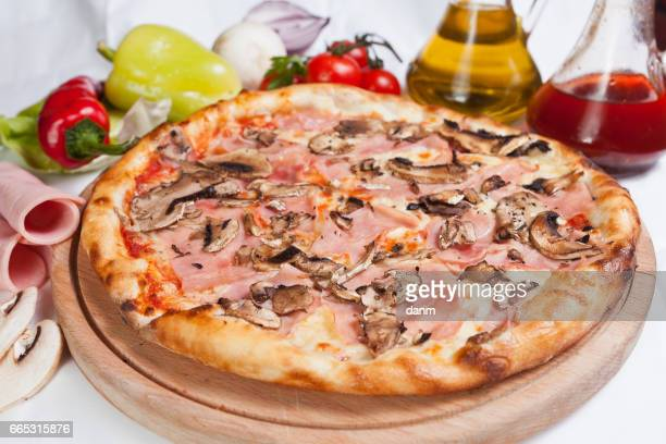 Pizza prosciutto on a white background with ingredients around