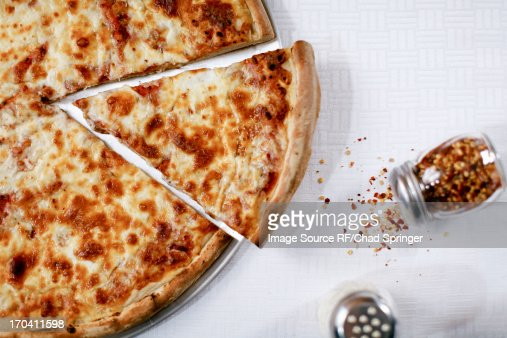 Pizza slice with spilled chili flakes