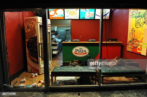 Pizza store lies vandalised after rivel antigovernment and Red Shirt supporters clash outside Rajamala Stadium where the rival the Red Shirts are...