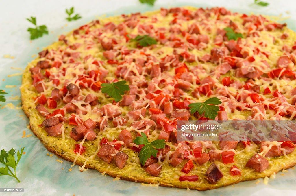 Pizza - the basis of zucchini, ham and paprika. : Stock Photo