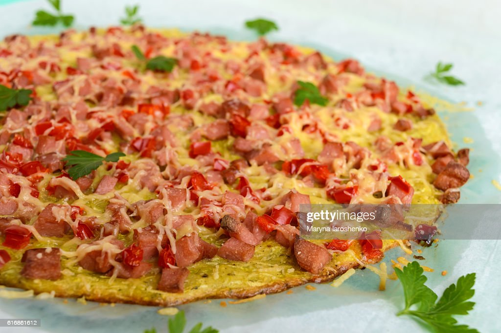 Pizza - the basis of zucchini, ham and paprika. : Stock Photo