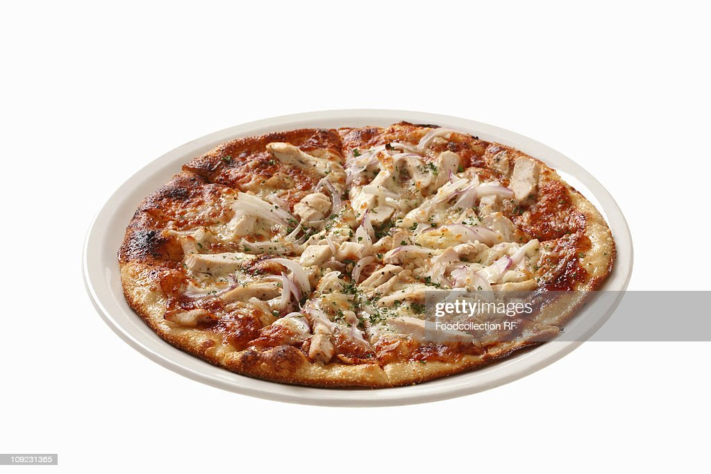 Pizza topped with chicken, mushrooms and red onions, close-up : Stock Photo