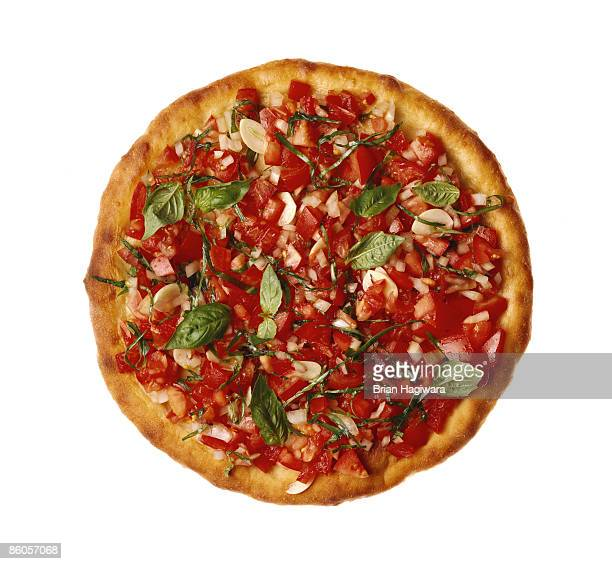 Pizza with fresh tomato , onion , and basil
