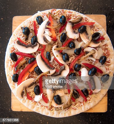 Pizza with mushroom, onion, pepper and black olive topping