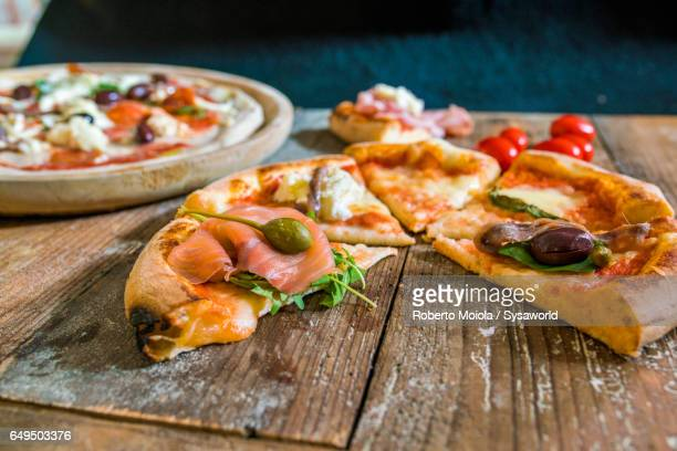 Pizza with rocket salad and salmon