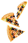 Pizza with shrimp, olives, green pepper and onion isolated. toning. selective focus