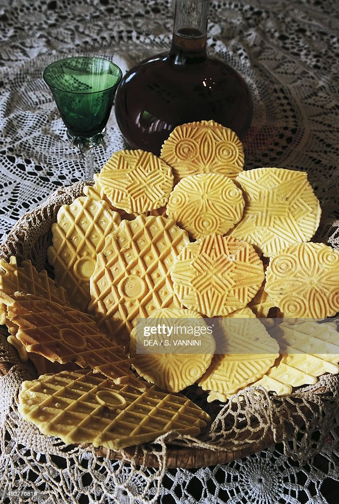 Pizzelle (or ferratelle waffle cookies), sweets made from fresh baked cookie dough cooked between a red-hot double plate over a fire, Sulmona, Abruzzo, Italy.