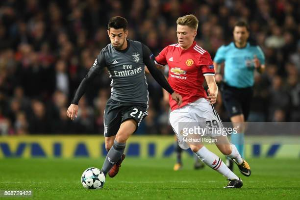 Pizzi of Benfica and Scott McTominay of Manchester United battle for possession during the UEFA Champions League group A match between Manchester...
