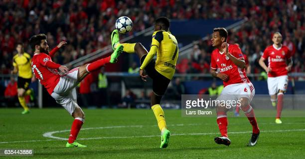 Pizzi of Benfica challenges Ousmane Dembele of Dortmund during the UEFA Champions League Round of 16 first leg match between SL Benfica and Borussia...