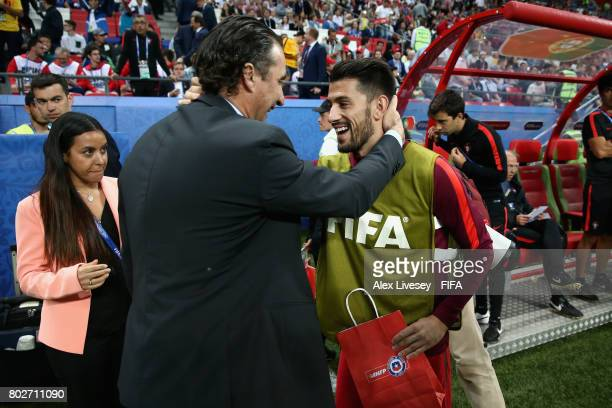 Pizzi of Portugal and Juan Antonio Pizzi of Chile embrace prior to the FIFA Confederations Cup Russia 2017 SemiFinal between Portugal and Chile at...